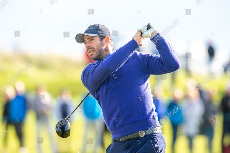 Former Liverpool footballer and Sky Sports pundit, Jamie Redknapp plays his tee shot from the second tee during the third round of the Alfred Dunhill Links Championship European Tour at St Andrews, West Sands