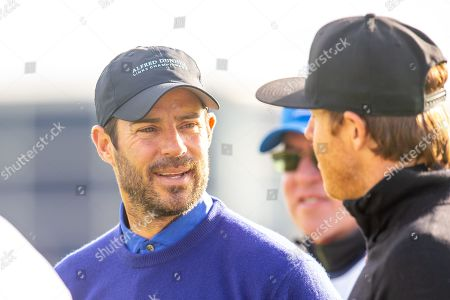 Stock Photo of Former Liverpool footballer and Sky Sports pundit, Jamie Redknapp chats with Ryan Smith on the second tee during the third round of the Alfred Dunhill Links Championship European Tour at St Andrews, West Sands