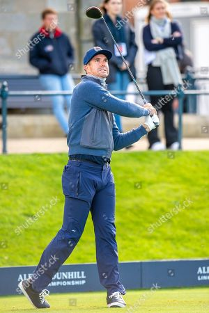 Stock Picture of Former England cricketer Kevin Pietersen watches his tee shot on the first hole during the third round of the Alfred Dunhill Links Championship European Tour at St Andrews, West Sands