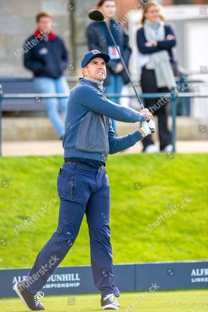 Stock Image of Former England cricketer Kevin Pietersen watches his tee shot on the first hole during the third round of the Alfred Dunhill Links Championship European Tour at St Andrews, West Sands
