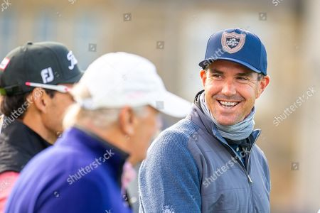 Stock Photo of Former England cricketer Kevin Pietersen is all smiles as he heads off down the first fairway during the third round of the Alfred Dunhill Links Championship European Tour at St Andrews, West Sands