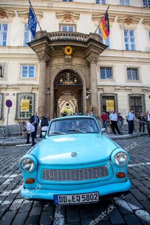 East Germany-made Trabant car stands in front of German embassy during 30th anniversary of East Germans exodus in Prague, Czech Republic, 28 September 2019. In September 1989, over 4,000 GDR citizens, many of them arrived in their Trabant-brand cars, climbed over the fence into the gardens of the West German Embassy in Prague where on 30 September 1989 West German Foreign Minister Hans-Dietrich Genscher addressed them his legendary speech from the embassy's balcony in which he informed them their departure to West Germany was granted.