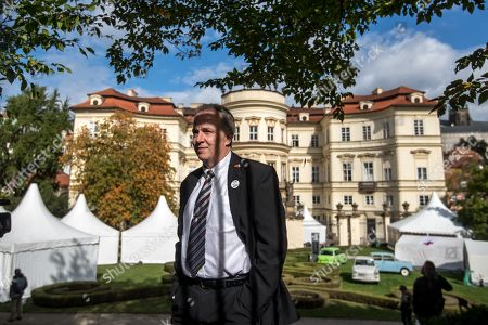 Former refugee Jens Hase stands behind the fence of the German embassy during 30th anniversary of East Germans exodus in Prague, Czech Republic, 28 September 2019. In September 1989, over 4,000 GDR citizens, many of them arrived in their Trabant-brand cars, climbed over the fence into the gardens of the West German Embassy in Prague where on 30 September 1989 West German Foreign Minister Hans-Dietrich Genscher addressed them his legendary speech from the embassy's balcony in which he informed them their departure to West Germany was granted.