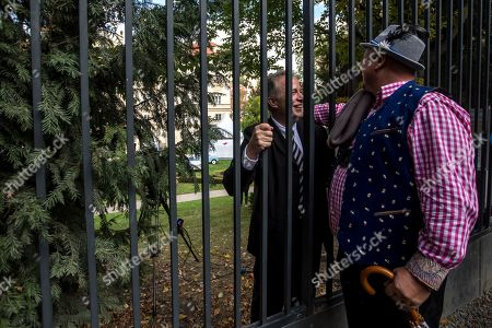 Former refugees talk through the fence of the German embassy during the 30th anniversary of East Germans' exodus in Prague, Czech Republic, 28 September 2019. In September 1989, over 4,000 GDR citizens, many of them arrived in their Trabant-brand cars, climbed over the fence into the gardens of the West German Embassy in Prague where on 30 September 1989 West German Foreign Minister Hans-Dietrich Genscher addressed them his legendary speech from the embassy's balcony in which he informed them their departure to West Germany was granted.