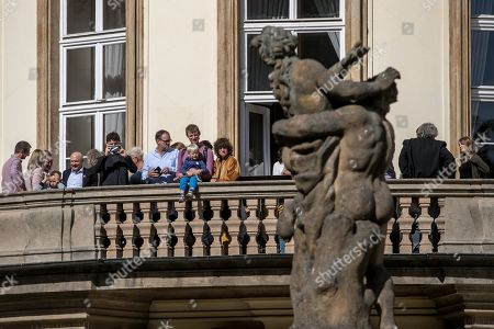 Former refugees and their relatives take part in the 30th anniversary of East Germans' exodus at German embassy in Prague, Czech Republic, 28 September 2019. In September 1989, over 4,000 GDR citizens, many of them arrived in their Trabant-brand cars, climbed over the fence into the gardens of the West German Embassy in Prague where on 30 September 1989 West German Foreign Minister Hans-Dietrich Genscher addressed them his legendary speech from the embassy's balcony in which he informed them their departure to West Germany was granted.