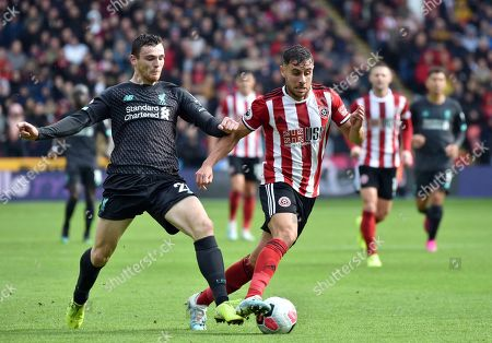 Liverpool's Andrew Robertson, left, duels for the ball with Sheffield United's George Baldock during the English Premier League soccer match between Sheffield United and Liverpool at Bramall Lane in Sheffield, England