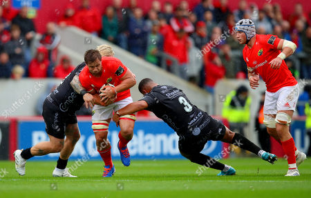 Munster vs Dragons. Munster's Arno Botha is tackled by Dragons' Leon Brown and Richard Hibbard