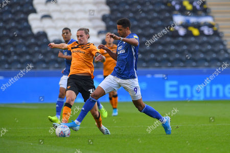 Hull City player Jackson Irvine (36) and Cardiff City player Robert Glatzel (9)during the EFL Sky Bet Championship match between Hull City and Cardiff City at the KCOM Stadium, Kingston upon Hull