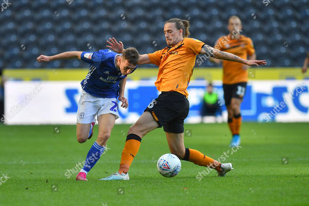 Hull City player Jackson Irvine (36) and Cardiff City player Gavin Whyte (20)  during the EFL Sky Bet Championship match between Hull City and Cardiff City at the KCOM Stadium, Kingston upon Hull