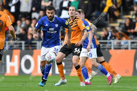 Cardiff City player Marlon Pack (15) and Hull City player Jackson Irvine (36)  during the EFL Sky Bet Championship match between Hull City and Cardiff City at the KCOM Stadium, Kingston upon Hull