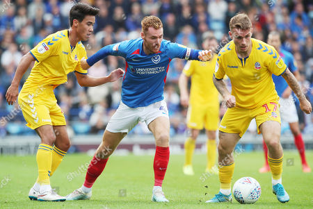 Portsmouth's Tom Naylor battles with Bolton Wanderers's Thibaud Verlinden  and Bolton Wanderers's Adam Chicksen