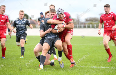 Stock Image of Tom James of Scarlets battles with Jack Crowley of Munster for the ball.
