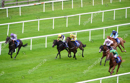 CURRAGH. MAKE ME SWAY and Willie Byrne (left) win for trainer Jim Bolger from Athlumney Hall (right).