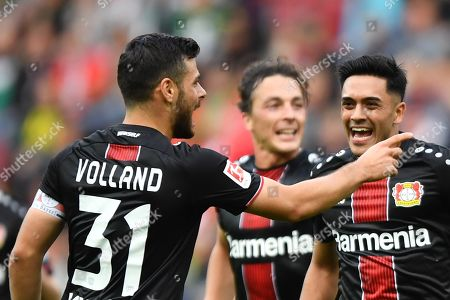 Leverkusen's Kevin Volland (L) and Leverkusen's Isaac Kiese Thelin celebrate during the German Bundesliga soccer match between FC Augsburg and Bayer 04 Leverkusen in Augsburg, Germany, 28 September 2019.