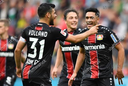 Leverkusen's Kevin Volland (front) and Leverkusen's Isaac Kiese Thelin (R) celebrate during the German Bundesliga soccer match between FC Augsburg and Bayer 04 Leverkusen in Augsburg, Germany, 28 September 2019.