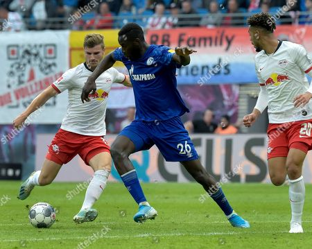 Leipzig's Timo Werner, left, and Schalke's Salif Sane, right, challenge for the ball during the German Bundesliga soccer match between RB Leipzig and FC Schalke 04 in Leipzig, Germany