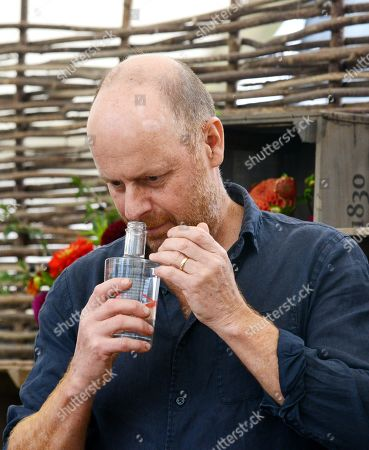 Time for Gin, BBC Gardeners World TV presenter Joe Swift at the new 'Gin Show' at the Malvern Autumn Show at the Three Counties Showground in Malvern