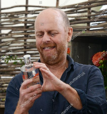 Stock Photo of Time for Gin, BBC Gardeners World TV presenter Joe Swift at the new 'Gin Show' at the Malvern Autumn Show at the Three Counties Showground in Malvern
