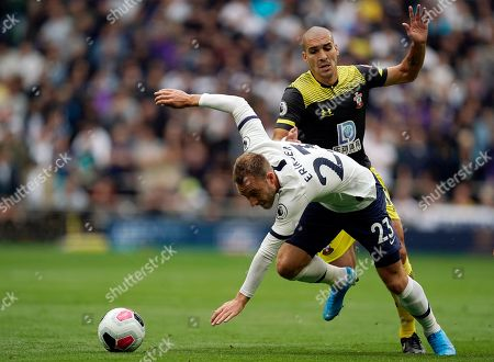 Stock Photo of Tottenham's Christian Eriksen (L) vies for the ball against Southampton's Oriol Romeu (R) during the English Premier League soccer match between Tottenham Hotspur and Southampton at Tottenham Hotspur Stadium, London, Britain, 28 September 2019.