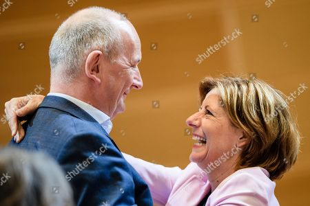 Stock Picture of Rhineland-Palatinate State Premier and the co-interim chairwoman of the Social Democratic Party (SPD) Malu Dreyer (R) and Premier of Brandenburg Dietmar Woidke (L) of the Social Democratic Party (SPD) hug as they greet each other during the beginning of a closed board meeting of the Social Democratic Party (SPD) in Berlin, Germany, 28 September 2019. During the closed meeting, guideline motions for the upcoming party convention from 06 to 08 December 2019 will be resolved.