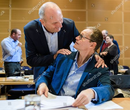 Premier of Brandenburg Dietmar Woidke (L) of the Social Democratic Party (SPD) and Berlin Governing Mayor Michael Mueller (R) of the Social Democratic Party (SPD) greet each other during the beginning of a closed board meeting of the Social Democratic Party (SPD) in Berlin, Germany, 28 September 2019. During the closed meeting, guideline motions for the upcoming party convention from 06 to 08 December 2019 will be resolved.