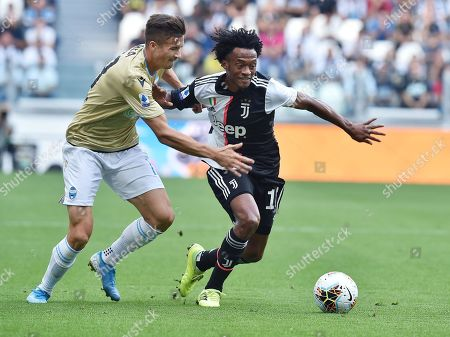 Stock Picture of Juventus' Juan Cuadrado (R) and Spal's Arkadiusz Reca in action during the Italian Serie A soccer match between Juventus FC and S.P.A.L at Allianz stadium in Turin, Italy, 28 September 2019.