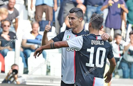 Juventus Cristiano Ronaldo (L) celebrates with teammate Paulo Dybala after scoring during the Italian Serie A soccer match between Juventus FC and S.P.A.L at Allianz stadium in Turin, Italy, 28 September 2019.