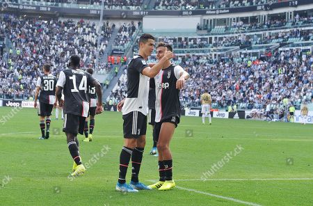 Juventus' Cristiano Ronaldo (L) celebrates with teammate Paulo Dybala after scoring during the Italian Serie A soccer match between Juventus FC and S.P.A.L at Allianz stadium in Turin, Italy, 28 September 2019.