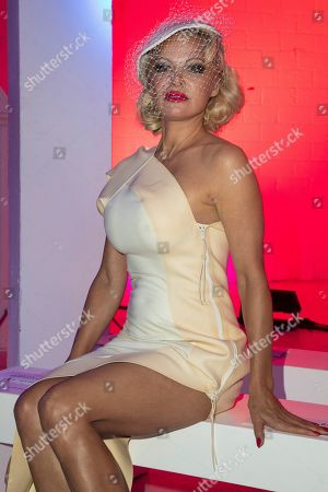 Pamela Anderson attends the Vivienne Westwood Ready To Wear Spring-Summer 2020 collection, unveiled during the fashion week, in Paris