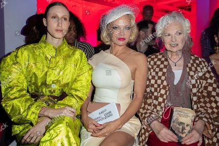 Pamela Anderson, Anna Cleveland, Vivienne Westwood. Actress Pamela Anderson, from left, designer Vivienne Westwood and model Anna Cleveland pose for photographers prior to the Vivienne Westwood Ready To Wear Spring-Summer 2020 collection, unveiled during the fashion week, in Paris