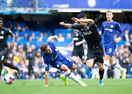 Steven Alzate of Brighton and Hove Albion dives over Cesar Azpilicueta of Chelsea