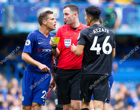 Referee Christopher Cavanagh separates Cesar Azpilicueta of Chelsea and Steven Alzate of Brighton and Hove Albion