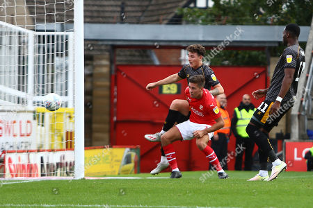 Stock Image of Danny McNamara of Newport County can only watch as the ball goes narrowly wide