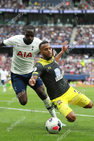 Stock Photo of Southampton's Ryan Bertrand, right, and Tottenham's Moussa Sissoko, left, vie for the ball during the English Premier League soccer match between Tottenham Hotspur and Southampton at the White Heart Lane stadium in London