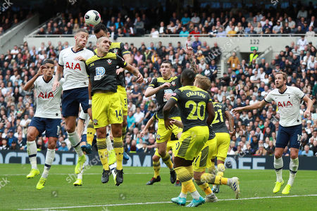 Stock Picture of Tottenham's Harry Kane, right, watches as teammate Christian Eriksen, second left, jumps with Southampton's Oriol Romeu to head the ball during the English Premier League soccer match between Tottenham Hotspur and Southampton at the White Heart Lane stadium in London