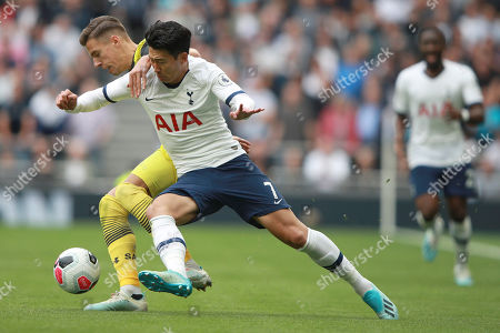 Southampton's Jan Bednarek, left, and Tottenham's Son Heung-min vie for the ball during the English Premier League soccer match between Tottenham Hotspur and Southampton at the White Heart Lane stadium in London