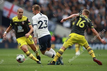 Southampton's Oriol Romeu, left, Tottenham's Christian Eriksen, center, and Southampton's James Ward-Prowse, right, vie for the ball during the English Premier League soccer match between Tottenham Hotspur and Southampton at the White Heart Lane stadium in London