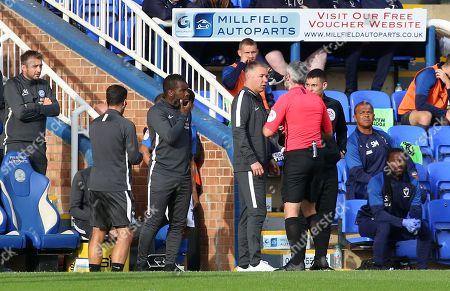 Peterborough United Manager Darren Ferguson speaks to Match Referee S Stockbridge
