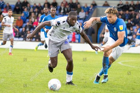 Colchester United forward Frank Nouble tackled by  Macclesfield Town defender Theo Vassell during the EFL Sky Bet League 2 match between Macclesfield Town and Colchester United at Moss Rose, Macclesfield