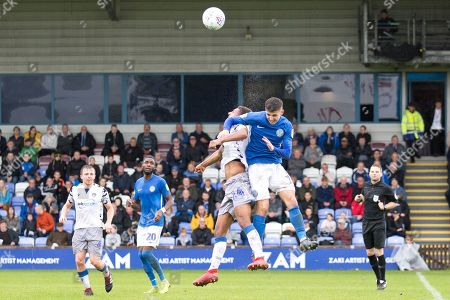 Colchester United midfielder Brandon Comley in a tackle with the opponentduring the EFL Sky Bet League 2 match between Macclesfield Town and Colchester United at Moss Rose, Macclesfield