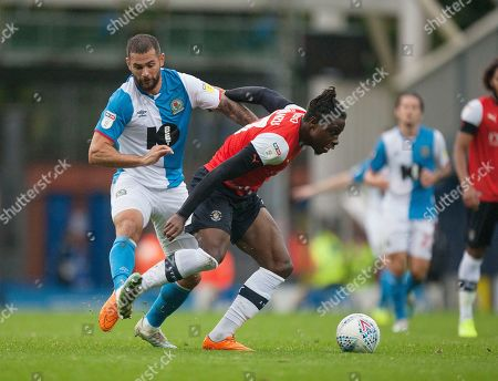 Bradley Johnson of Blackburn Rovers (L) and Pelly Ruddock of Luton Town in action
