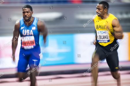 Justin Galtlin (L) from the United States in action next to Yohan Blake from Jamaica, during the men's 100m semi final at the IAAF World Athletics Championships 2019 at the Khalifa Stadium in Doha, Qatar, 28 September 2019.