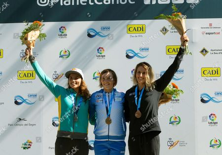 Slovenian Eva Tercelj (C) celebrates on the podium with her gold medal in the women's K1 race of the 2019 ICF Canoe Slalom World Championships next to silver medalist Australian Jessica Fox (L) and bronze medalist New Zealander Luuka Jones (R) in La Seu d'Urgell, Spain, 28 September 2019.