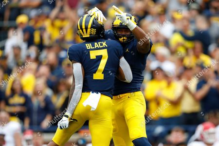 Michigan wide receiver Nico Collins (4) celebrates his 48-yard touchdown reception with Tarik Black (7) in the first half of an NCAA college football game against Rutgers in Ann Arbor, Mich