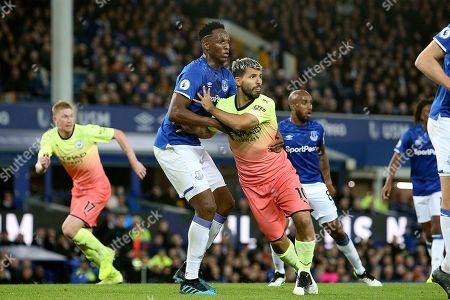 Manchester City forward Sergio Aguero (10) fends off Everton defender Yerry Mina (13) during the Premier League match between Everton and Manchester City at Goodison Park, Liverpool