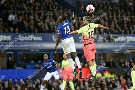 Manchester City forward Sergio Aguero (10) and Everton defender Yerry Mina (13) go for the high ball during the Premier League match between Everton and Manchester City at Goodison Park, Liverpool