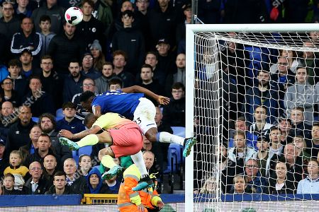 Manchester City forward Gabriel Jesus (9) and Everton defender Yerry Mina (13) challenge for the ball in the box during the Premier League match between Everton and Manchester City at Goodison Park, Liverpool
