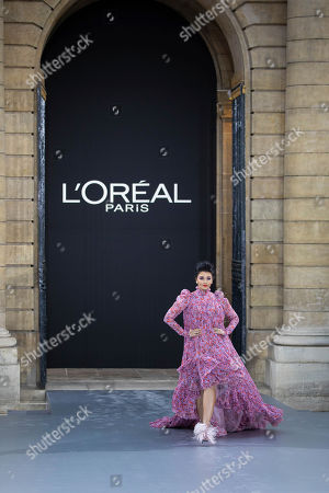 Aishwarya Rai Bachchan blows a kiss as she wears a creation as part of the L'Oreal Ready To Wear Spring-Summer 2020 collection, unveiled during the fashion week, in Paris