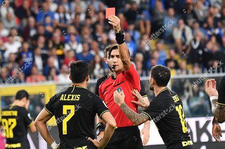 Refeere Gianpaolo Calvarese shows the red card to Inter's Alexis Sanchez (L) during the Italian Serie A soccer match UC Sampdoria vs FC Inter at the Luigi Ferraris stadium in Genoa, Italy, 28 September 2019.