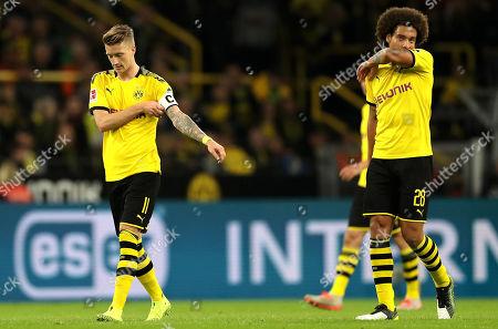 Dortmund's Marco Reus (L) and Dortmund's Axel Witsel react during the German Bundesliga soccer match between Borussia Dortmund and SV Werder Bremen in Dortmund, Germany, 28 September 2019.